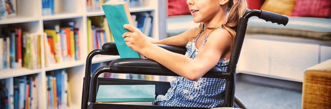 Disabled girl reading book in library