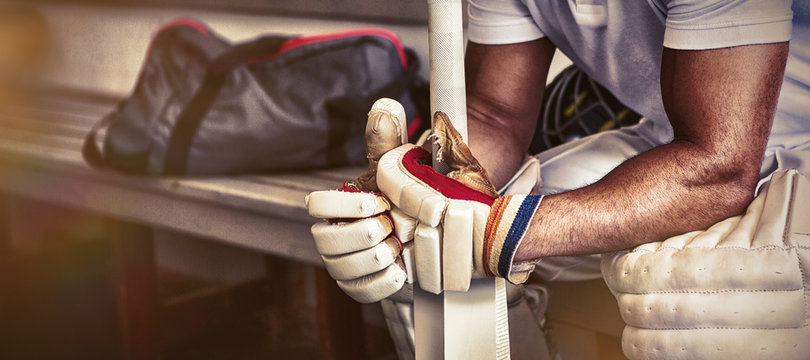 Stressed cricket player sitting on bench