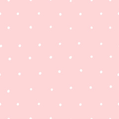 Cute seamless pink pattern with white dots. Polka dot background