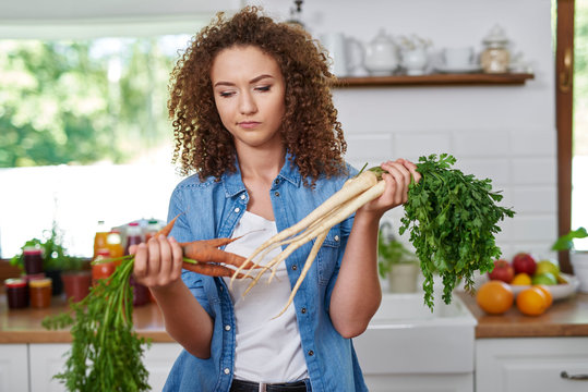 Young woman thinking of what to cook