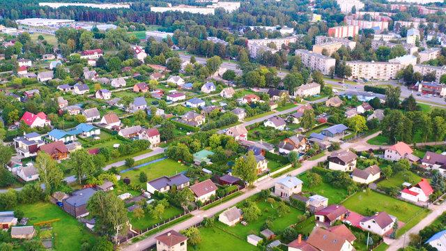 Aerial view of the city. Hundreds of houses bird eye view suburb urban housing development.