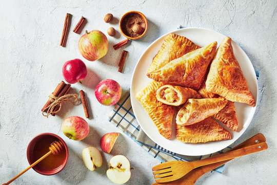 sweet apple turnover on a white plate