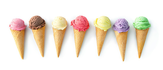 Various varieties of ice cream in cones isolated