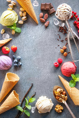 Various varieties of ice cream on gray stone background
