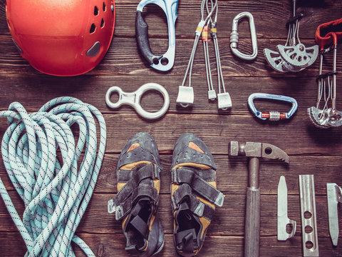 climbing equipment  on dark wooden background, top view