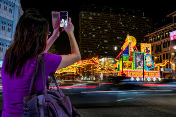 A woman takes pictures of giant lanterns in Chinatown in Singapore