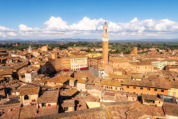 Panoramic view of Siena city in Italy with Piazza del Campo and the Torre del Mangia, Tuscany region, Italy