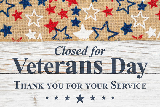 Veterans Day closed message with stars on a weathered whitewash wood