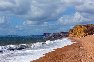 Wall Mural - Freshwater Bay beach and waves Dorset view towards sandstone cliffs, West Bay and Golden Cap