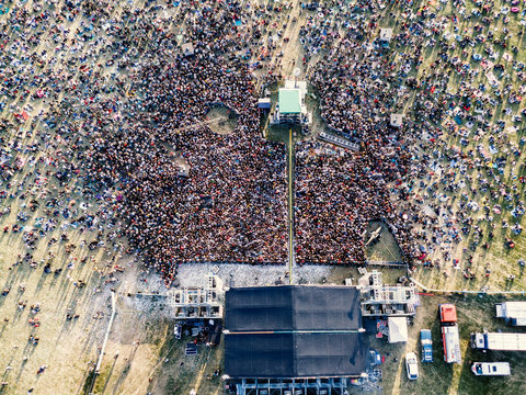 Summer music festival. People near stage.