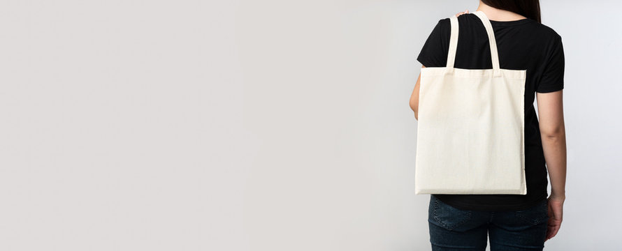 Woman Holding Eco Bag With Her Back To Camera, Panorama