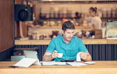 Owner of a restaurant checking financial business documentations - Accountant looking worried over the profit and loss accountancy papers