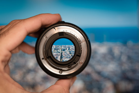 Barcelona general view through camera lens. Photography and travel concept.