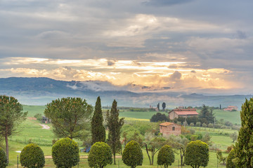 Sunset in Tuscany with rolling hills in a rural landscape view