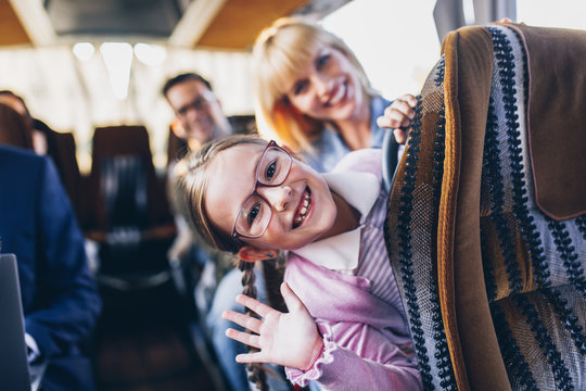Happy passengers traveling by bus.