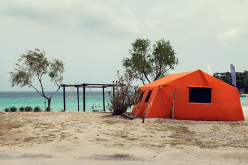 One orange tent on a beach in Greece Romantic vacation Selective focus