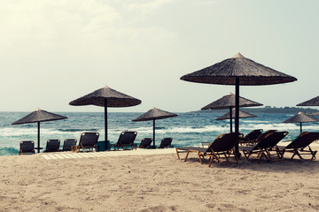 Greece beach with straw umbrellas and chairs Selective focus