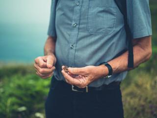 Close up on senior man's hands holding seeds