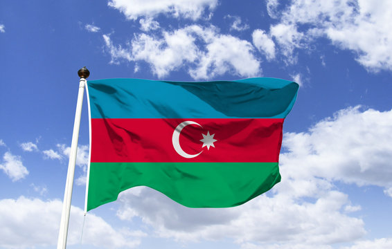 Model of Azerbaijan Flag fluttering in the wind under the blue sky. Surrounded by the Caspian Sea and Caucasus Mountains. Capital: Baku. Maiden Tower Shirvanshahs Palace
