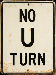 Rusted No U Turn Sign