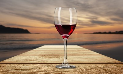 Red wine glass on wooden desk