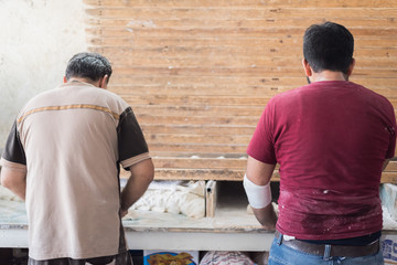 two workers in bakery shop