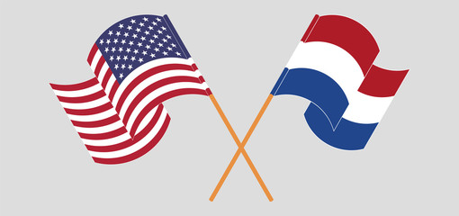 Crossed and waving flags of Netherlands and the USA