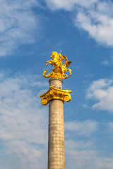 Monument to St. George against the sky