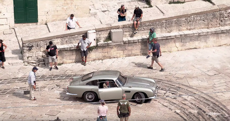 Film crew and an Aston Martin DB5 are seen on the set of the new James Bond movie 'No Time to Die' in Matera