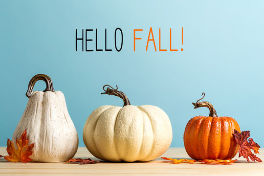 Hello fall message with pumpkins on a blue background