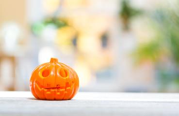 Little pumpkin on a bright interior room background