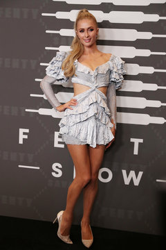 Paris Hilton poses on the red carpet of Rihanna's new Savage X Fenty collection show for New York Fashion Week at the Barclays Center in the Brooklyn