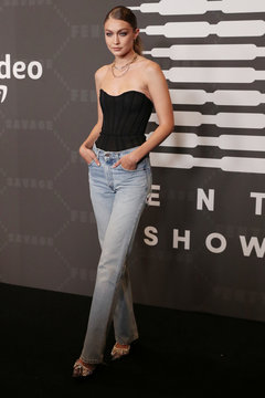 Model Gigi Hadid poses on the red carpet of Rihanna's new Savage X Fenty collection show for New York Fashion Week at the Barclays Center in the Brooklyn