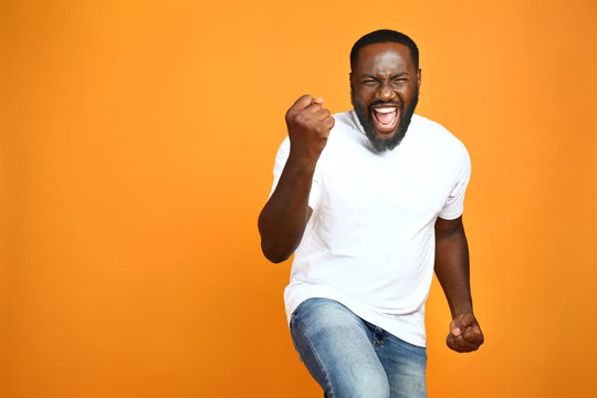 Happy African-American man on color background