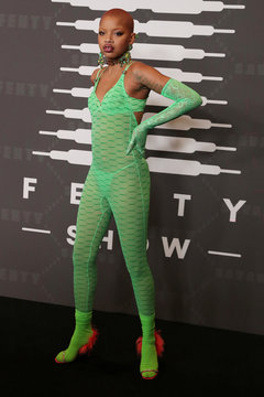 Model Slick Woods poses on the red carpet of Rihanna's new Savage X Fenty collection show for New York Fashion Week at the Barclays Center in the Brooklyn borough of New York
