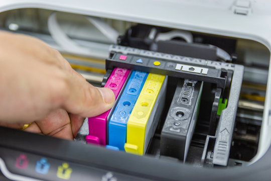 Technicians are install setup the ink cartridge or inkjet cartridge is a component of an inkjet printer