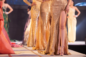 Models with Golden sparking sequin evening gown ball dress walk on Fashion Show of Spring Summer trend in International Fashion Week 2020, present high heel shoes