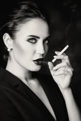 smoking blonde in black