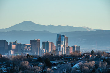 Denver skyline against a background of mountains