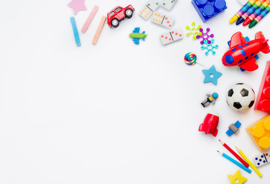 Frame of kids toys on white background with copy space