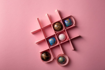 Pink food background with chocolate