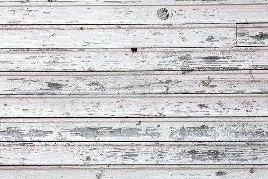 White wood background. Vintage white wood. Beautiful white floor from boards. Photo texture, concept. Table top wood white. Weathered wood table white painted background