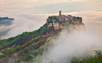 Civita di Bagnoregio, Viterbo, Lazio, Italy: landscape at dawn with fog