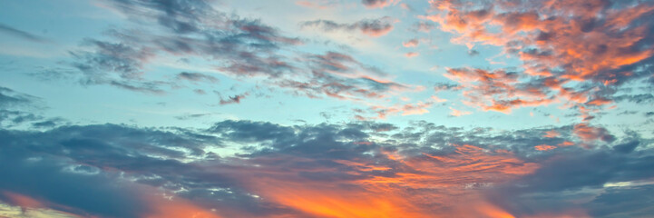 Wall Mural - Blue and orange sky with clouds, panoramic background