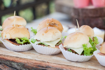 Tasty mini burgers, snacks arranged for the guests at the reception.