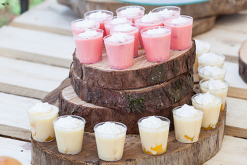 Tasty creamy mini desserts in cups ready for guests at the wedding reception.