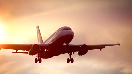 air plane in sunset sky Fototapete