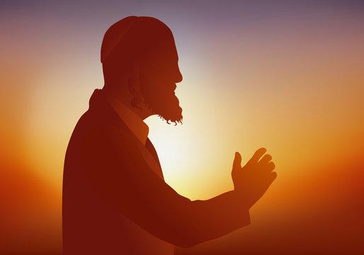 Symbole de la religion judaïque avec un Rabbin qui prie et prêche devant ses fidèles en portant un habit traditionnel.