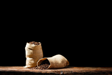 Fresh coffee grains in brown sack and free space for your decoration.