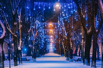 The street is decorated for Christmas. Deserted street with garlands. New year in Russia. Christmas city decorations. Fantastic beauty. Sense of celebration. Festive illumination